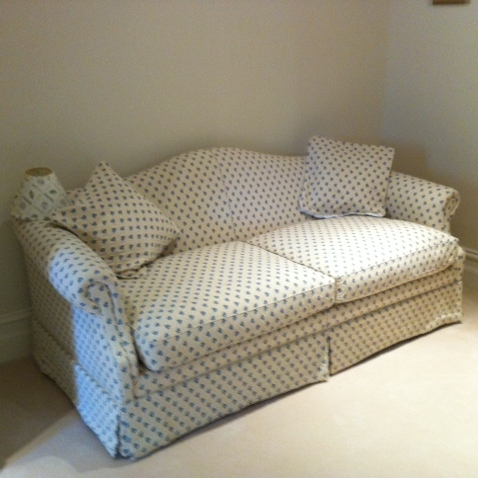 White and blue spotted sofa